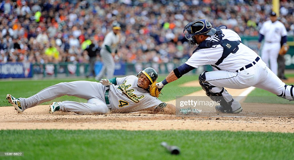 <a gi-track='captionPersonalityLinkClicked' href=/galleries/search?phrase=Coco+Crisp&family=editorial&specificpeople=206376 ng-click='$event.stopPropagation()'>Coco Crisp</a> #4 of the Oakland Athletics is tagged out at home <a gi-track='captionPersonalityLinkClicked' href=/galleries/search?phrase=Gerald+Laird&family=editorial&specificpeople=228949 ng-click='$event.stopPropagation()'>Gerald Laird</a> #9 of the Detroit Tigers in the top of the third inning during Game Two of the American League Division Series at Comerica Park on October 7, 2012 in Detroit, Michigan.