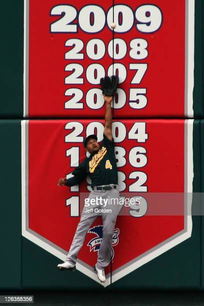 Coco Crisp of the Oakland Athletics leaps but doesn't make the catch on a fly ball triple by Howie Kendrick of the Los Angeles Angels of Anaheim in...