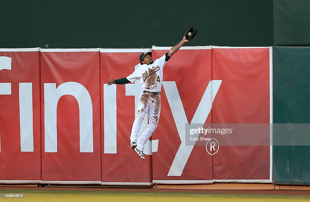 <a gi-track='captionPersonalityLinkClicked' href=/galleries/search?phrase=Coco+Crisp&family=editorial&specificpeople=206376 ng-click='$event.stopPropagation()'>Coco Crisp</a> #4 of the Oakland Athletics makes a catch at the wall in the second inning against the Detroit Tigers during Game Three of the American League Division Series at Oakland-Alameda County Coliseum on October 9, 2012 in Oakland, California.