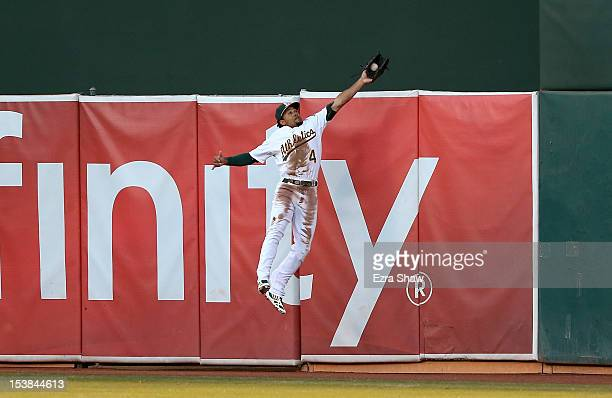 Coco Crisp of the Oakland Athletics makes a catch at the wall in the second inning against the Detroit Tigers during Game Three of the American...