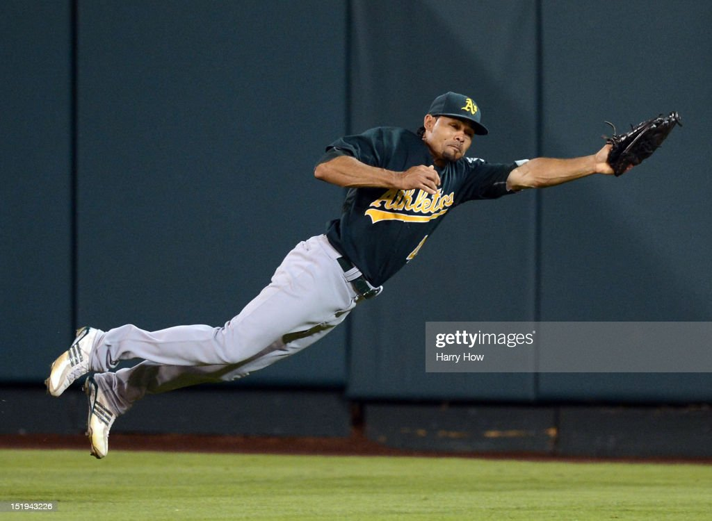 <a gi-track='captionPersonalityLinkClicked' href=/galleries/search?phrase=Coco+Crisp&family=editorial&specificpeople=206376 ng-click='$event.stopPropagation()'>Coco Crisp</a> #4 of the Oakland Athletics makes a diving catch for an out of Chris Iannetta #17 of the Los Angeles Angels during the fifth inning at Angel Stadium of Anaheim on September 12, 2012 in Anaheim, California.