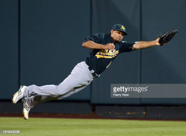 Coco Crisp of the Oakland Athletics makes a diving catch for an out of Chris Iannetta of the Los Angeles Angels during the fifth inning at Angel...