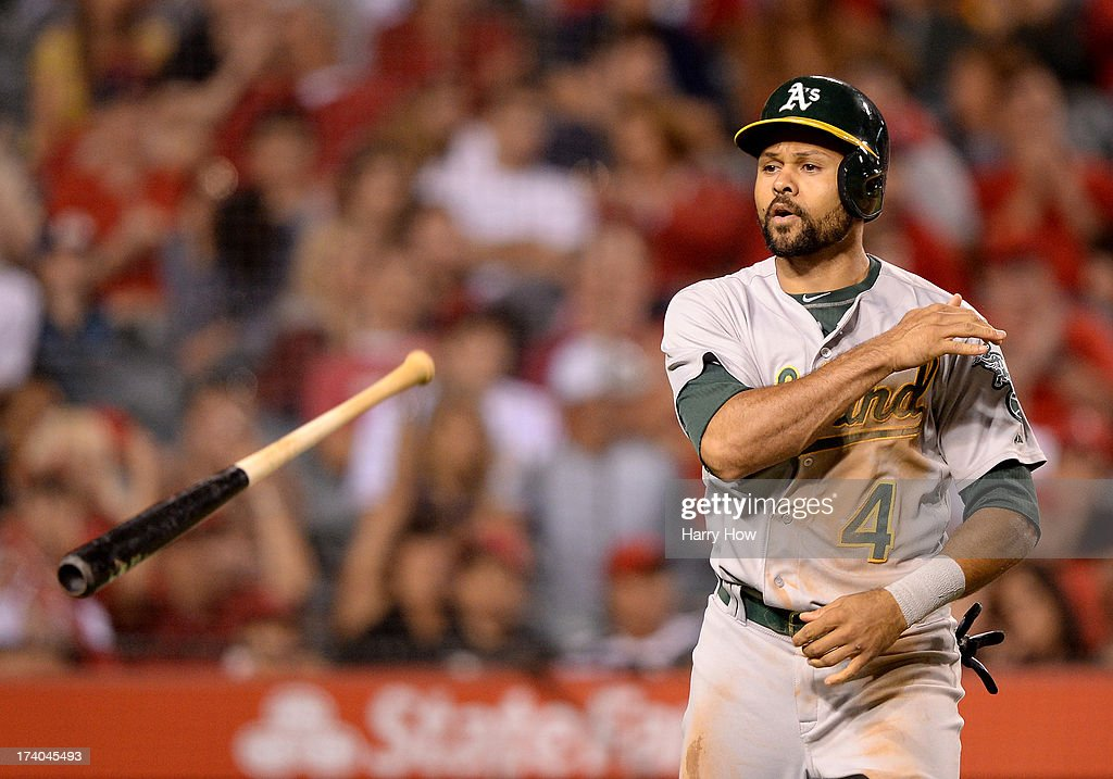 Coco Crisp #4 of the Oakland Athletics reacts to his strikeout to end the seventh inning against the Los Angeles Angels at Angel Stadium of Anaheim on July 19, 2013 in Anaheim, California.