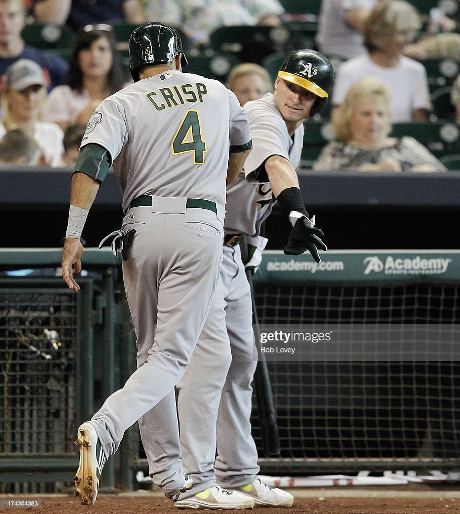 <a gi-track='captionPersonalityLinkClicked' href=/galleries/search?phrase=Coco+Crisp&family=editorial&specificpeople=206376 ng-click='$event.stopPropagation()'>Coco Crisp</a> #4 of the Oakland Athletics receives congratulations from <a gi-track='captionPersonalityLinkClicked' href=/galleries/search?phrase=Josh+Donaldson&family=editorial&specificpeople=4959442 ng-click='$event.stopPropagation()'>Josh Donaldson</a> #20 of the Oakland Athletics after hitting a two-run home run in the seventh inning against the Houston Astros at Minute Maid Park on July 24, 2013 in Houston, Texas.
