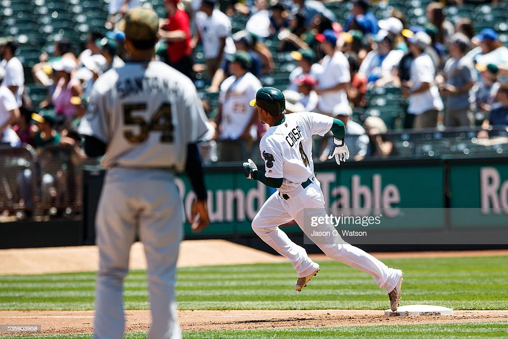 <a gi-track='captionPersonalityLinkClicked' href=/galleries/search?phrase=Coco+Crisp&family=editorial&specificpeople=206376 ng-click='$event.stopPropagation()'>Coco Crisp</a> #4 of the Oakland Athletics rounds the bases after hitting a home run off of <a gi-track='captionPersonalityLinkClicked' href=/galleries/search?phrase=Ervin+Santana&family=editorial&specificpeople=243096 ng-click='$event.stopPropagation()'>Ervin Santana</a> #54 of the Minnesota Twins during the first inning at the Oakland Coliseum on May 30, 2016 in Oakland, California.