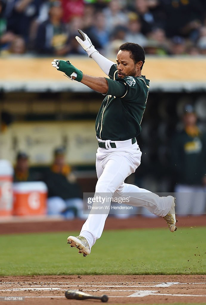 <a gi-track='captionPersonalityLinkClicked' href=/galleries/search?phrase=Coco+Crisp&family=editorial&specificpeople=206376 ng-click='$event.stopPropagation()'>Coco Crisp</a> #4 of the Oakland Athletics scores in the bottom of the first inning against the Texas Rangers at O.co Coliseum on June 16, 2014 in Oakland, California. Crisp scored on an RBI single from John Jaso.