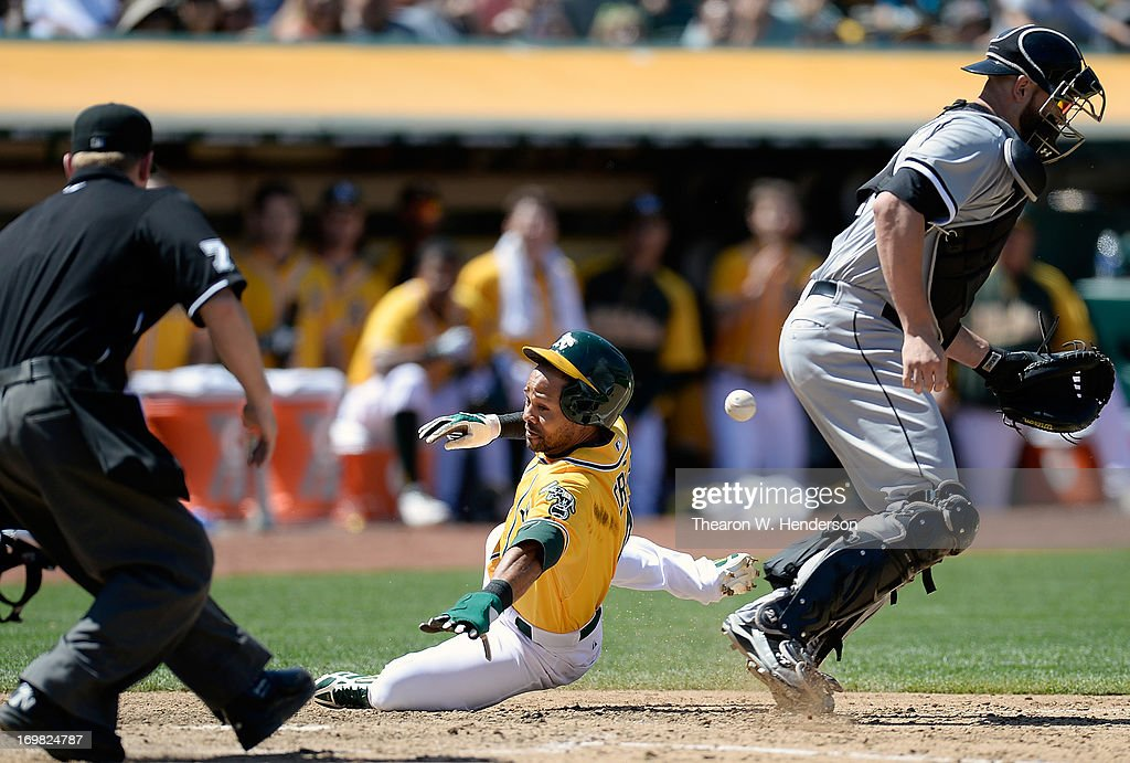<a gi-track='captionPersonalityLinkClicked' href=/galleries/search?phrase=Coco+Crisp&family=editorial&specificpeople=206376 ng-click='$event.stopPropagation()'>Coco Crisp</a> #4 of the Oakland Athletics scores on a sacrifice fly from Josh Donaldson #20 as the ball gets past catcher <a gi-track='captionPersonalityLinkClicked' href=/galleries/search?phrase=Tyler+Flowers&family=editorial&specificpeople=4217244 ng-click='$event.stopPropagation()'>Tyler Flowers</a> #21 of the Chicago White Sox during the six inning at O.co Coliseum on June 2, 2013 in Oakland, California.
