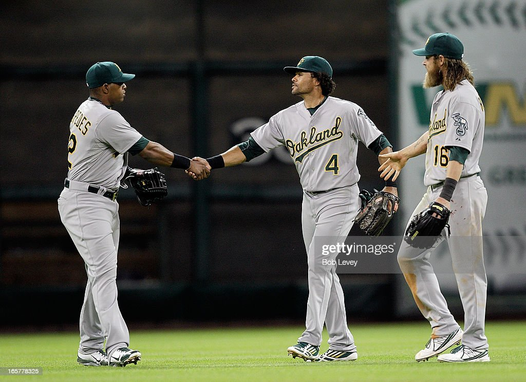 Coco Crisp #4 of the Oakland Athletics shakes hands with Yoenis Cespedes #52 of the Oakland Athletics and Josh Reddick #16 of the Oakland Athletics after the final out against the Houston Astros at Minute Maid Park on April 5, 2013 in Houston, Texas.