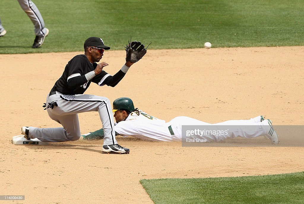 Coco Crisp #4 of the Oakland Athletics slides safely past Alexei Ramirez #10 of the Chicago White Sox to steal second base at Oakland-Alameda County Coliseum on May 15, 2011 in Oakland, California.