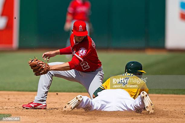 Coco Crisp of the Oakland Athletics steals second base ahead of a tag from Andrelton Simmons of the Los Angeles Angels of Anaheim during the third...