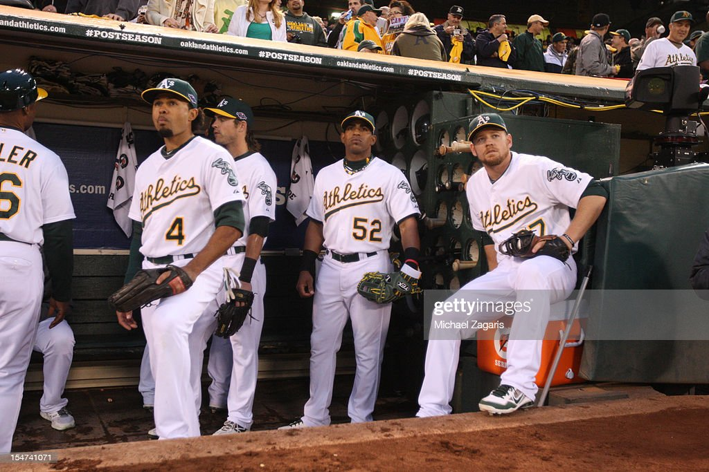 Coco Crisp #4, Yoenis Cespedes #52 and Brandon Moss #37 of the Oakland Athletics wait to take the field prior to the game against the Detroit Tigers at the Oakland-Alameda County Coliseum on October 11, 2012 in Oakland, California. The Tigers defeated the Athletics 6-0.