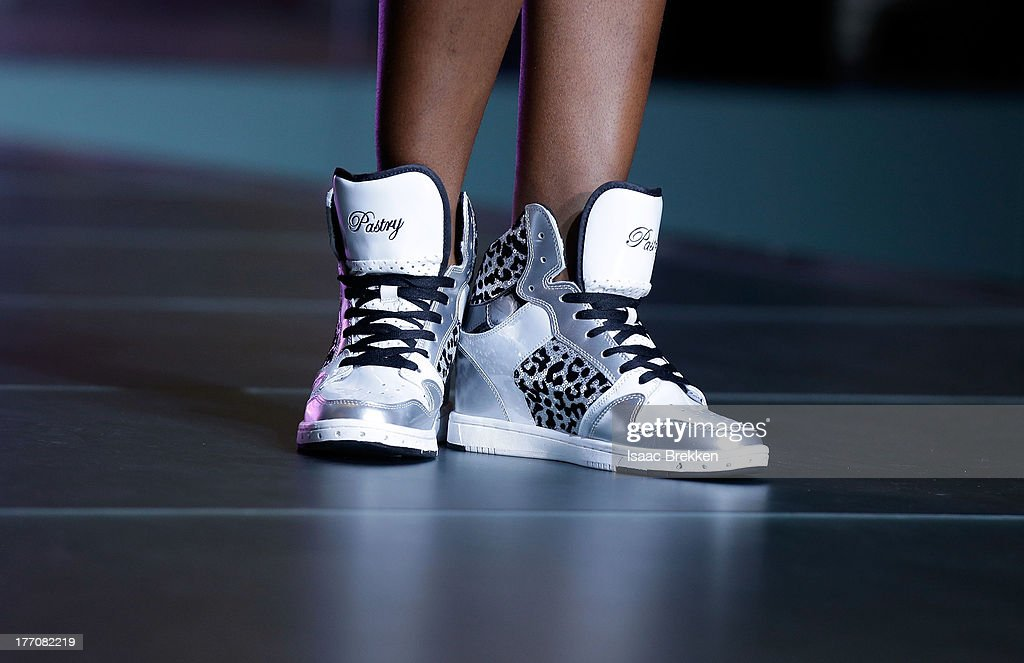 Coco Jones (shoe detail) performs during the Pastry Fashion Show with 1U mission at the Fashion Show mall on August 20, 2013 in Las Vegas, Nevada.