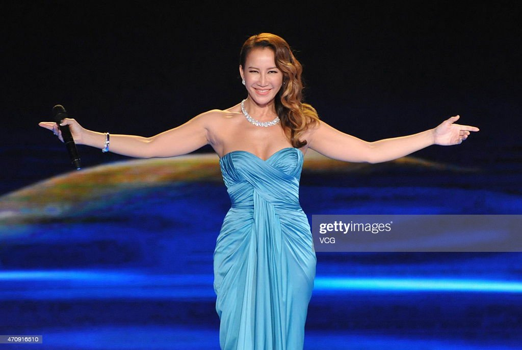 <a gi-track='captionPersonalityLinkClicked' href=/galleries/search?phrase=CoCo+Lee&family=editorial&specificpeople=2081343 ng-click='$event.stopPropagation()'>CoCo Lee</a> performs during the closing ceremony of the 5th Beijing International Film Festival at Beijing Yanqi Lake International Convention & Exhibition Center on April 23, 2015 in Beijing, China.