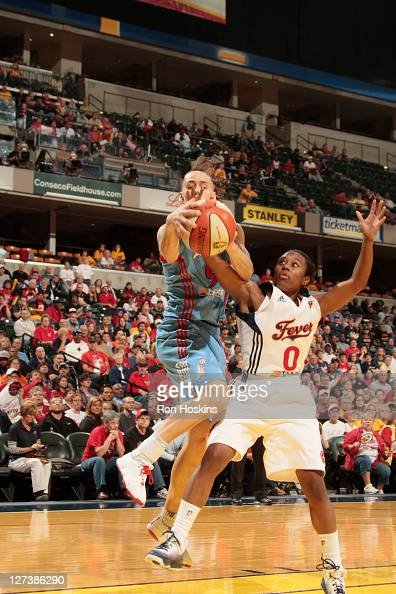 Coco Miller of the Atlanta Dream battles Shannon Bobbitt of the Indiana Fever in game three of the WNBA Eastern Conference Finals at Conseco...