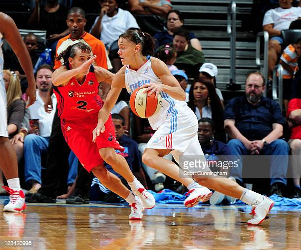 Coco Miller of the Atlanta Dream drives against her twin sister Kelly Miller of the Washington Mystics at Philips Arena on September 2 2011 in...