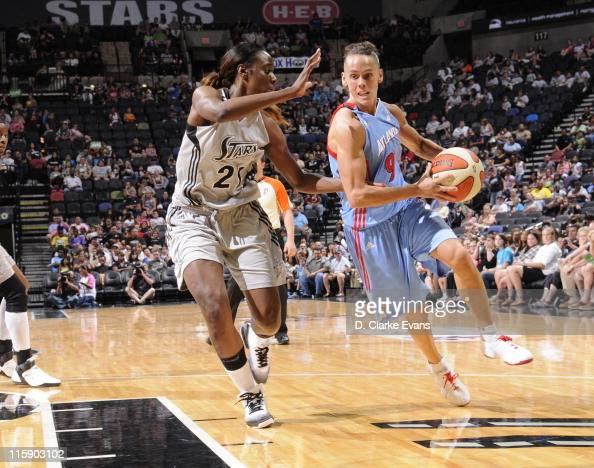Coco Miller of the Atlanta Dream drives against Porsha Phillips of the San Antonio Silver Stars at the ATT Center on June 11 2011 in San Antonio...