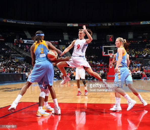 Coco Miller of the Atlanta Dream has the ball stripped by Michelle Snow of the Chicago Sky at Philips Arena on June 21 2011 in Atlanta Georgia NOTE...