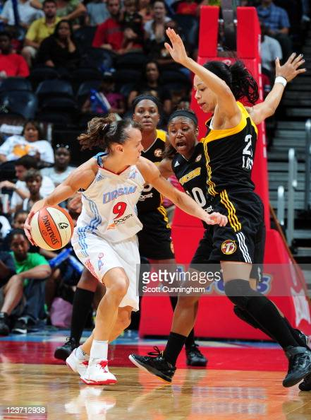 Coco Miller of the Atlanta Dream is defended by Jennifer Lacy and Andrea Riley of the Tulsa Shock at Philips Arena on September 4 2011 in Atlanta...