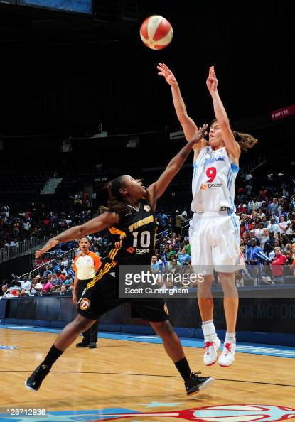 Coco Miller of the Atlanta Dream puts up a shot against Andrea Riley of the Tulsa Shock at Philips Arena on September 4 2011 in Atlanta Georgia NOTE...