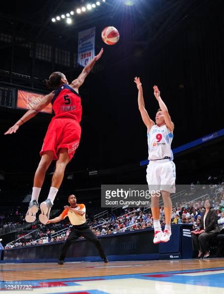 Coco Miller of the Atlanta Dream puts up a shot against Jasmine Thomas of the Washington Mystics at Philips Arena on September 2 2011 in Atlanta...