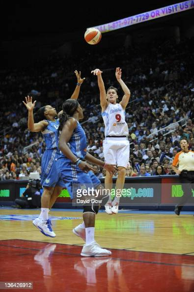 Coco Miller of the Atlanta Dream shoots against Monica Wright of the Minnesota Lynx during Game Three of the 2011 WNBA Finals at Philips Arena on...