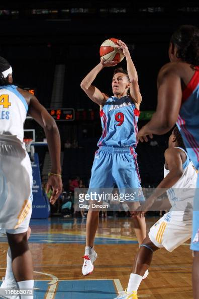 Coco Miller of the Atlanta Dream shoots past Sylvia Fowles and Epiphanny Prince of the Chicago Sky during the WNBA game on July 9 2011 at the...