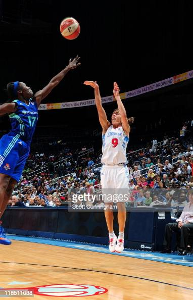 Coco Miller of the Atlanta Dream shoots the ball over Essence Carson of the New York Liberty at Philips Arena on June 30 2011 in Atlanta Georgia NOTE...