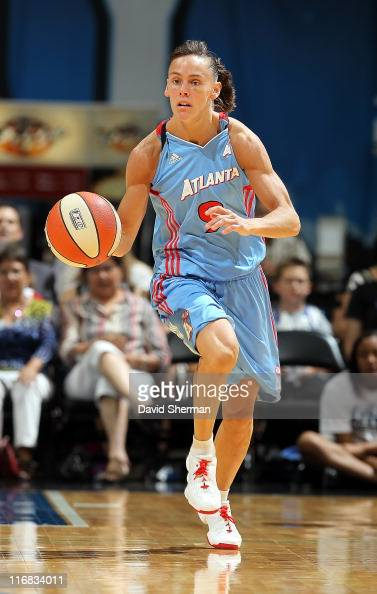 Coco Miller of the Atlanta Dream takes the ball down the court during the game against the Minnesota Lynx on June 17 2011 at Target Center in...