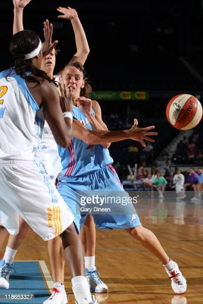 Coco Miller of the Atlanta Dream throws a pass while guarded by Michelle Snow and Angie Bjorklund of the Chicago Sky during the WNBA game on July 9...