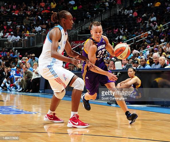 Coco Miller of the Los Angeles Sparks drives against Sancho Lyttle of the Atlanta Dream at Philips Arena on June 15 2012 in Atlanta Georgia NOTE TO...