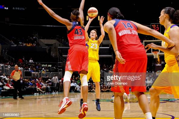Coco Miller of the Los Angeles Sparks shoots against Ashley Robinson of the Washington Mystics at the Staples Center on June 18 2012 in Los Angeles...