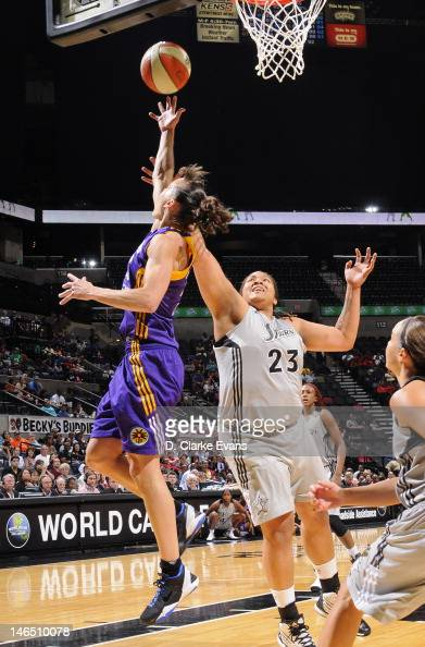 Coco Miller of the Los Angeles Sparks shoots against Danielle Adams of the San Antonio Silver Stars at the ATT Center on June 16 2012 in San Antonio...