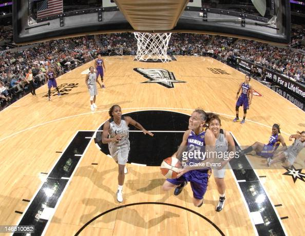Coco Miller of the Los Angeles Sparks shoots against Shenise Johnson and Danielle Adams of the San Antonio Silver Stars at the ATT Center on June 16...