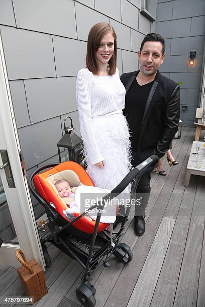 Coco Rocha and her husband James Conran pose with their newborn daughter at Christian Siriano Resort 2016 collection preview at Private Residence on...