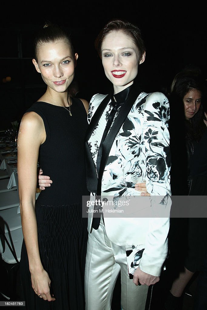 Coco Rocha (R) and Karlie Kloss attend the Glamour dinner for Patrick Demarchelier as part of the Paris Fashion Week Womenswear Spring/Summer 2014 at Monsieur Bleu restaurant on September 29, 2013 in Paris, France.