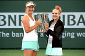 CoCo Vandeweghe and Bethanie MattekSands pose with the winner's tropy after defeating Julia Goerges of Germany and Karolina Pliskova of Czech...