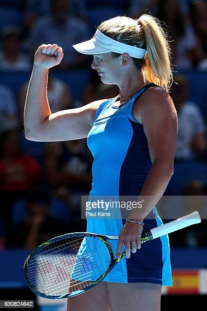 Coco Vandeweghe of the United States partnered with Jack Sock celebrates winning a point during the mixed doubles match against Lara Arruabarrena and...