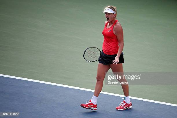 Coco Vandeweghe of the United States reacts after defeating Sloane Stephens of the United States in their Women's Singles First Round match on Day...