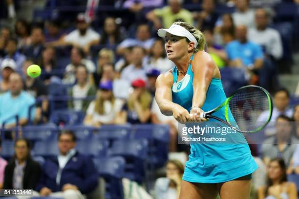 CoCo Vandeweghe of the United States returns a shot against Ons Jabeur of Tunisia during their second round Women's Singles match on Day Four of the...