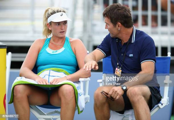 CoCo Vandeweghe of the United States speaks to her coach Pat Cash during a change over in her match against Anastasia Pavlyuchenkova of Russia during...