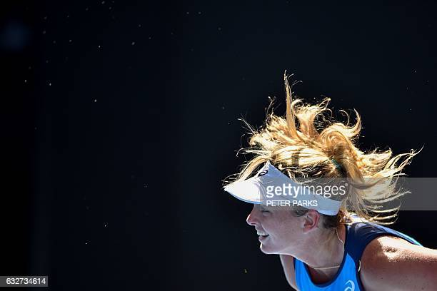TOPSHOT Coco Vandeweghe of the US serves against Venus Williams of the US during their women's singles semifinal match on day 11 of the Australian...