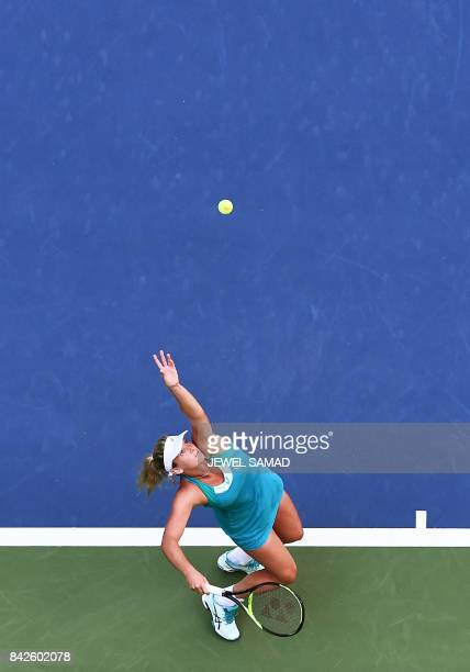 CoCo Vandeweghe of the US serves the ball to Lucie Safarova of the Czech Republic during their 2017 US Open Women's Singles Round 4 match at the USTA...