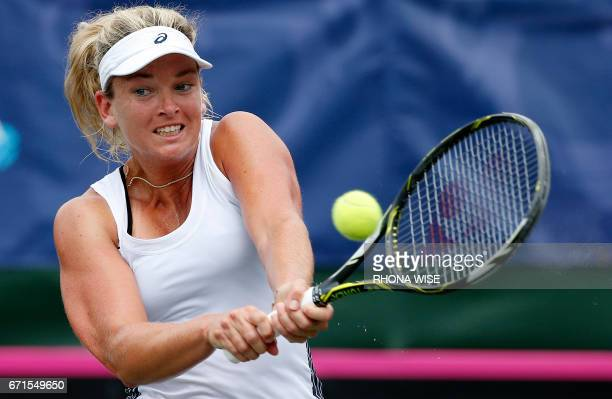 Coco Vandeweghe of the USA returns the ball to Marketa Vondrousova of Czech Republic during their semifinals Fed Cup match match in Tampa Florida...