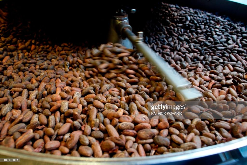 Cocoa beans are roasted at French chef Alain Ducasse's Manufacture de chocolat (Chocolate Factory), on February 19, 2013 in Paris.