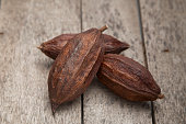 Cocoa pod on a dark rustic wooden table background