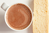 Hot cocoa with milk and baguette