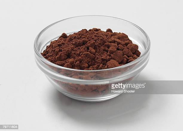 Cocoa powder in a glass bowl, studio shot