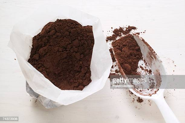 Cocoa powder in bag and scoop