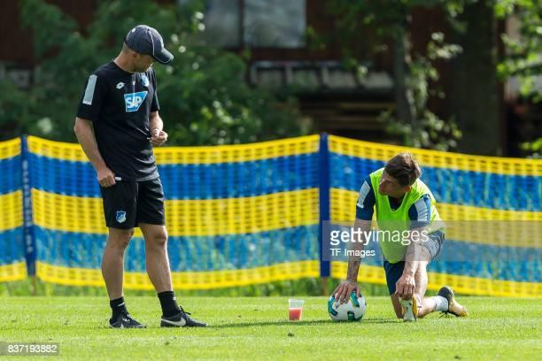 cocoach Alfred Schreuder of Hoffenheim speak with Steven Zuber of Hoffenheim during the Training Camp of TSG 1899 Hoffenheim on July 16 2017 in...