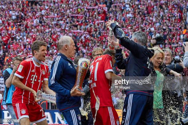 Cocoach Hermann Gerland of Bayern Muenchen Head coach Carlo Ancelotti of Bayern Muenchen and Philipp Lahm of Bayern Muenchen celebrates with beer...